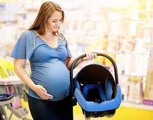 Pregnant lady buying car seat
