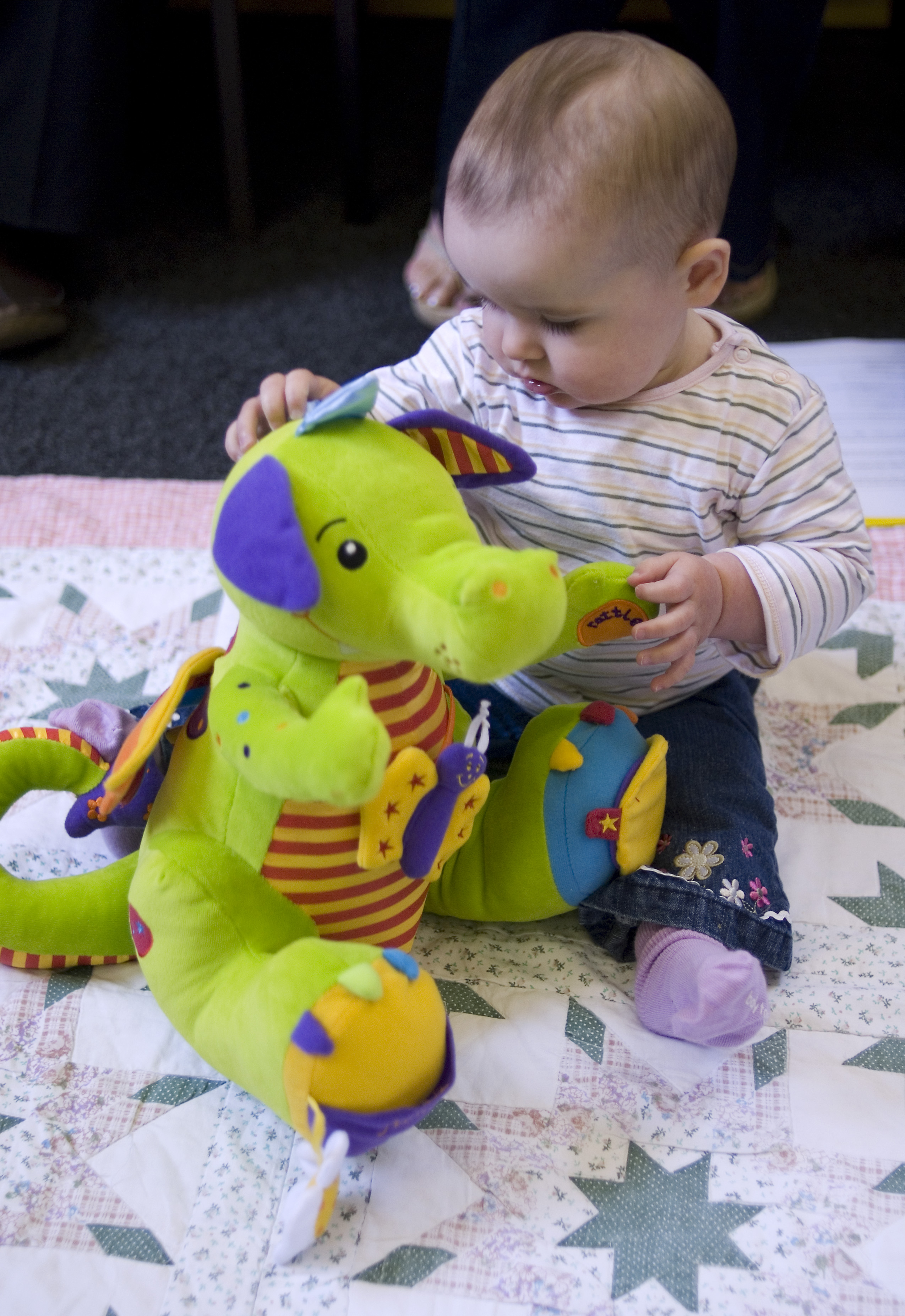 Baby playing with cuddly toy