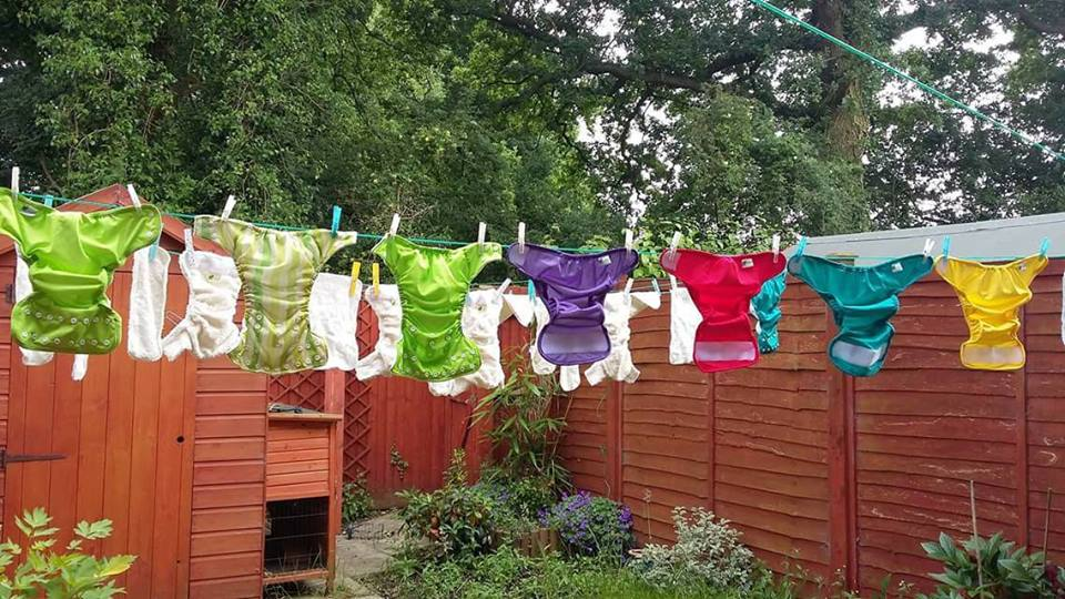 cloth nappies hanging on washing line