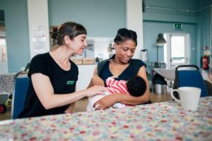 Breastfeeding counsellor supporting a mother with feeding