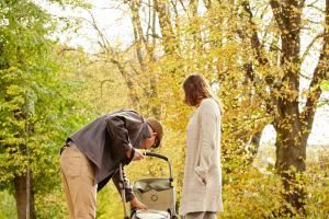 Parents with buggy in Autumn