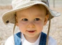 Toddler in sun hat