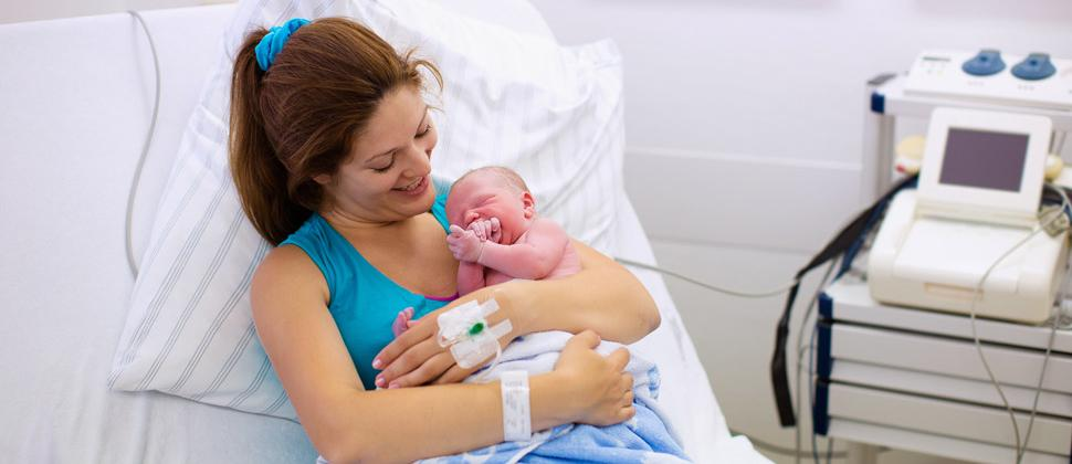 Woman and newborn baby