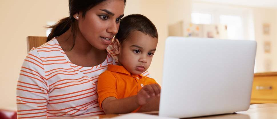 Woman and child on laptop