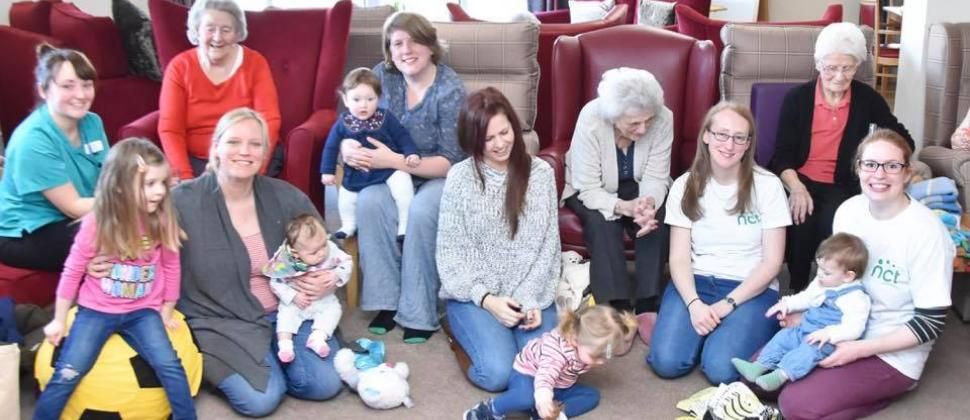 Volunteers and mums at our Bridging the Generations Group
