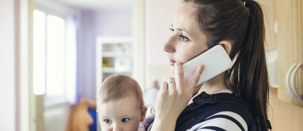 Woman with baby on phone